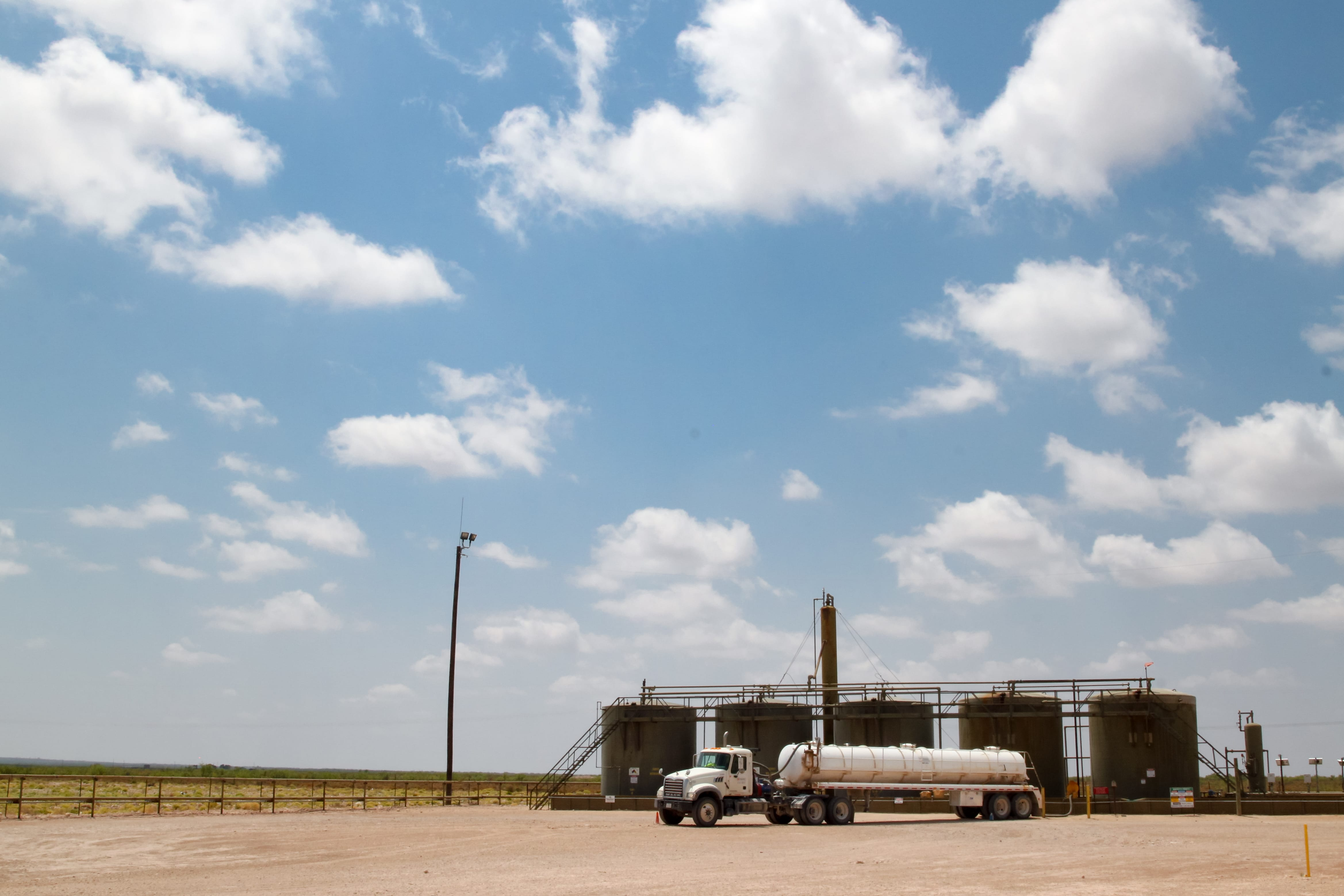 A truck stops at a site with four wells in Hobbs, N.M. (Robin Zielinski for the Center for Public Integrity)