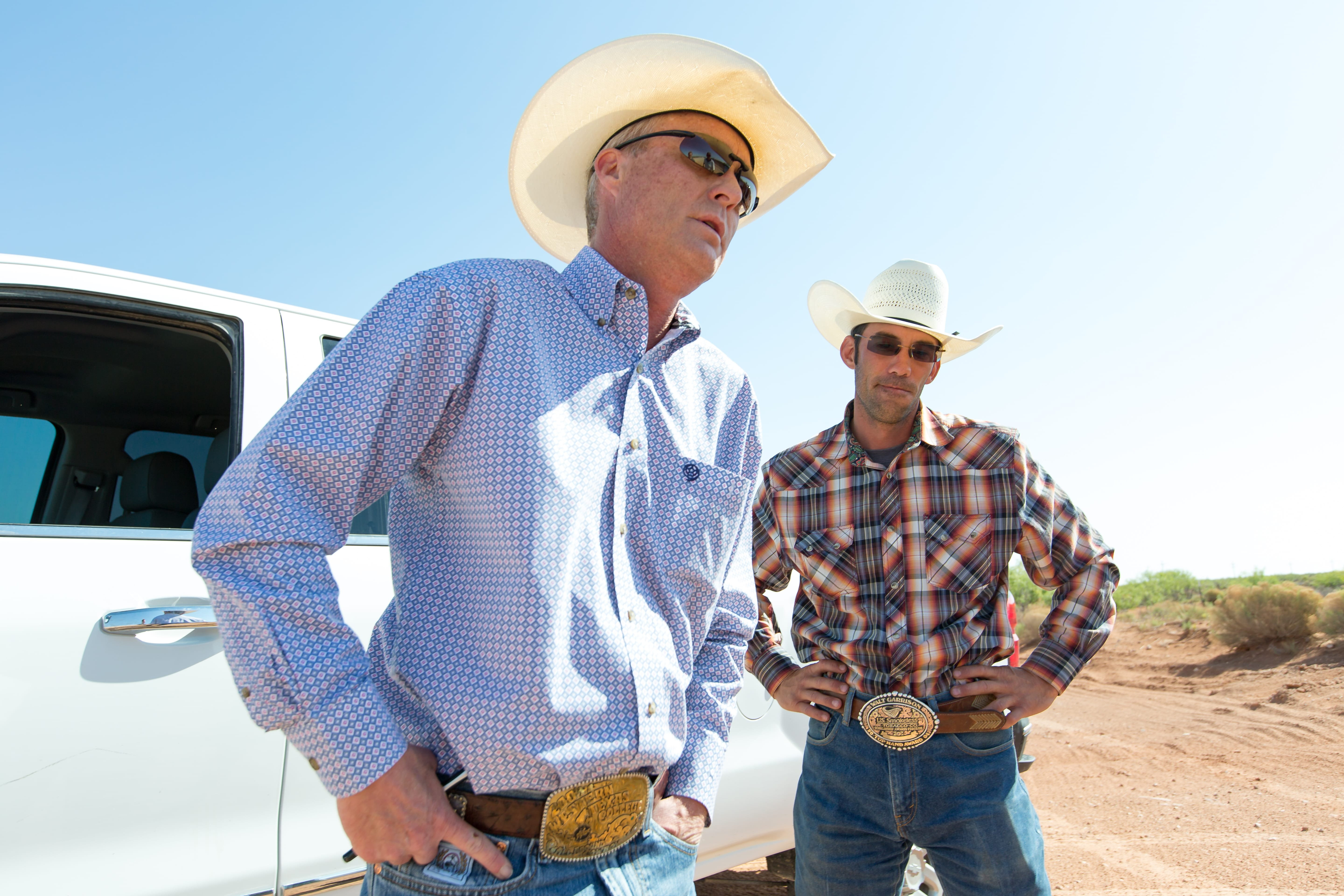 Wayne Smith (foreground) and business partner J.W. Todd have objected to the way the federal government manages oil production on public land that ranchers also lease in southeastern New Mexico. (Robin Zielinski for the Center for Public Integrity)