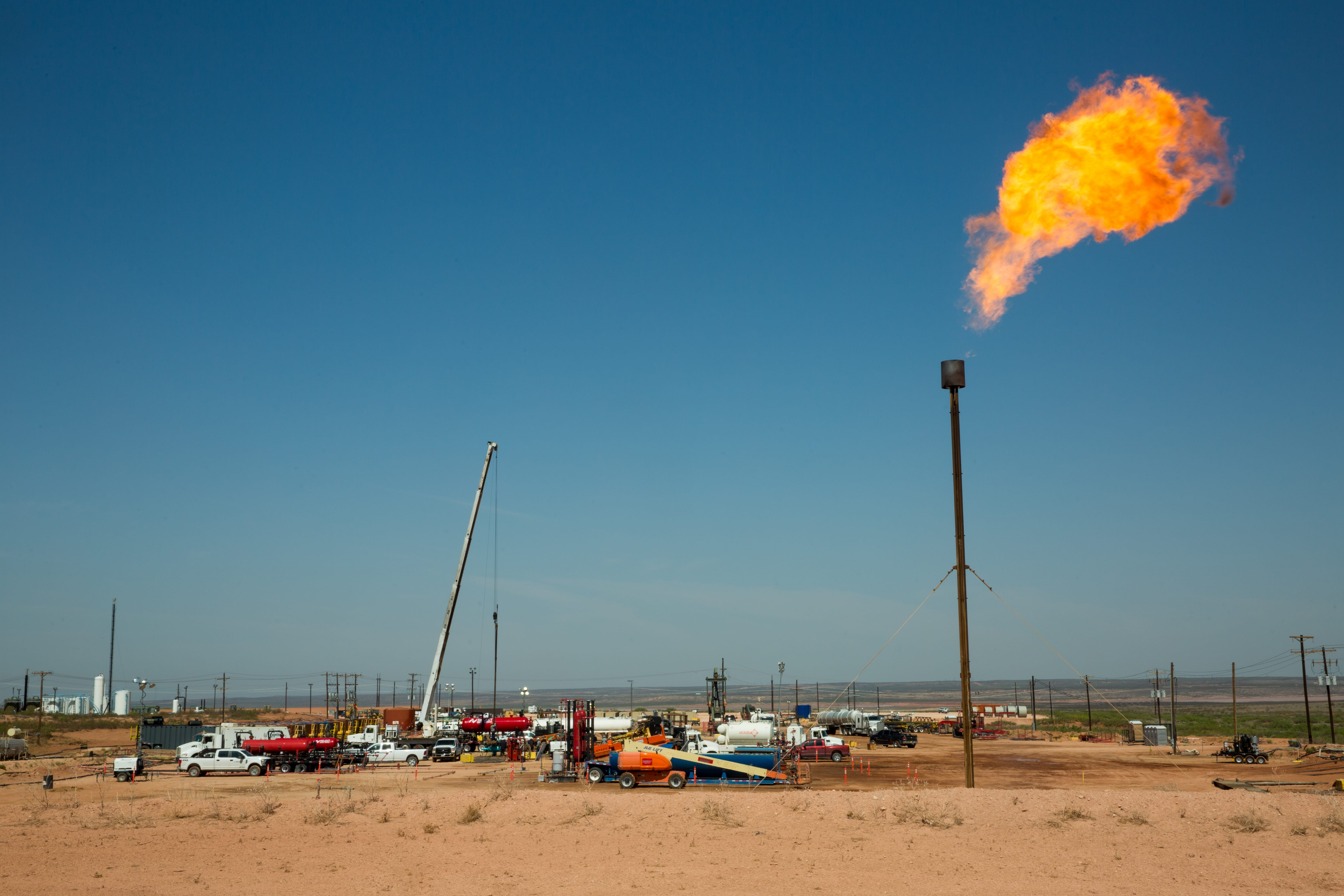 A flare burns atop a drill pad on land near Carlsbad, N.M., that Wayne Smith leased for ranching before his death in October. The development covered seven times more acreage than the Bureau of Land Management said would be used, Smith said in May. (Robin Zielinski for the Center for Public Integrity)